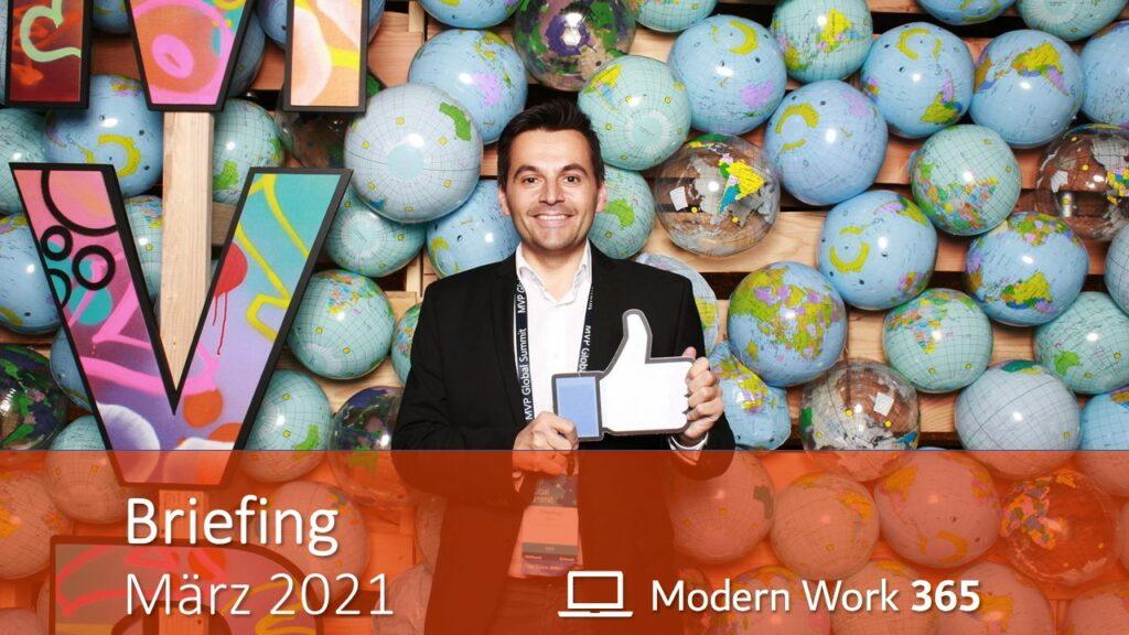 """Thomas Maier zeigt einen Daumen nach oben. Bild zeigt den Text """"Briefing März 2021"""" und das Logo des Modern Work 365 Teams (Laptop)."""